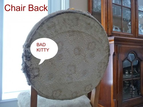 Chair needing reupholstery after cat damage