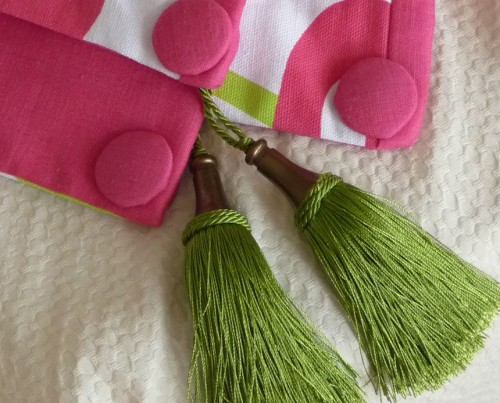 Custom throw with pink and green embelishments