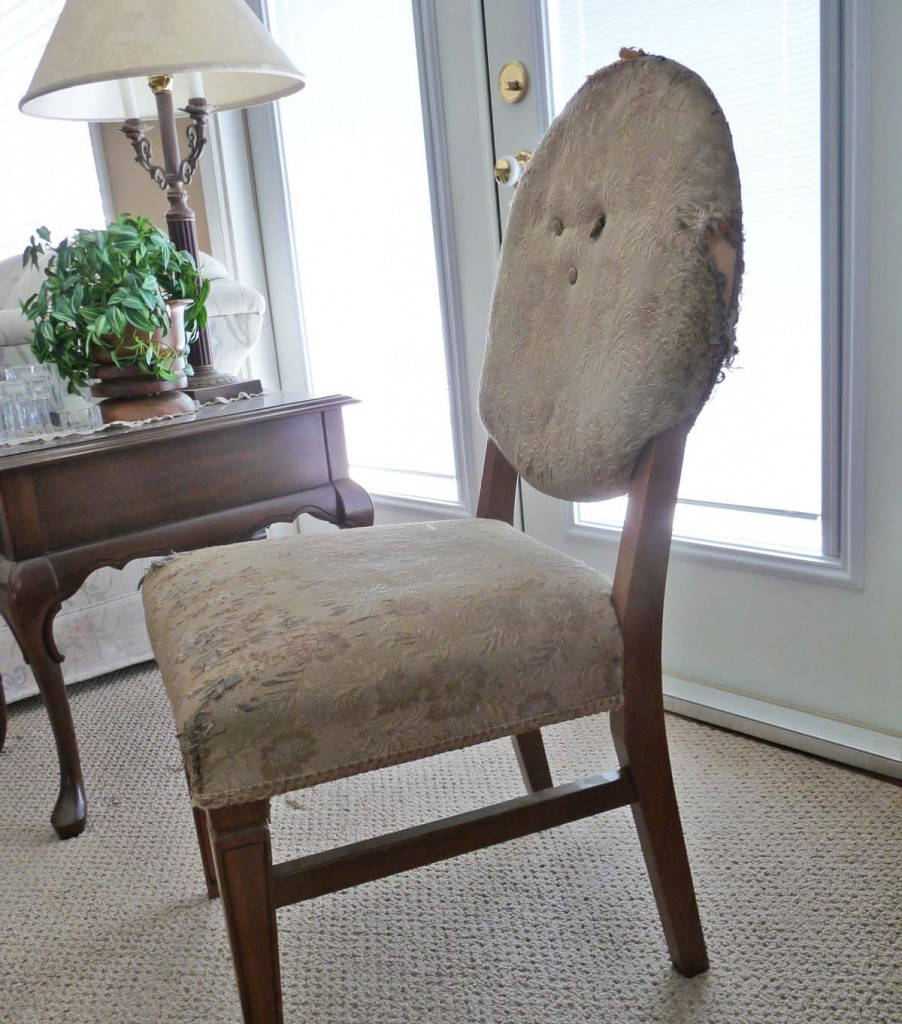 Round bacvk chair in need uf reupholstery