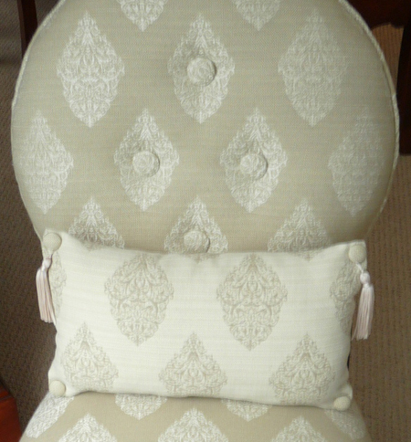 Pillow with buttons for tassels